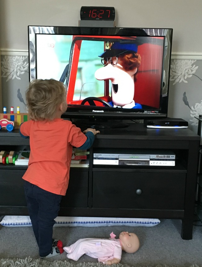 Planting, Postman Pat and a Picnic  toddler close to TV watching Postman Pat