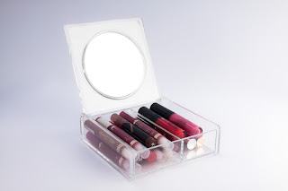 lip glosses in plexiglass box.jpeg