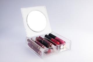 lip glosses in plexiglass box.jpeg