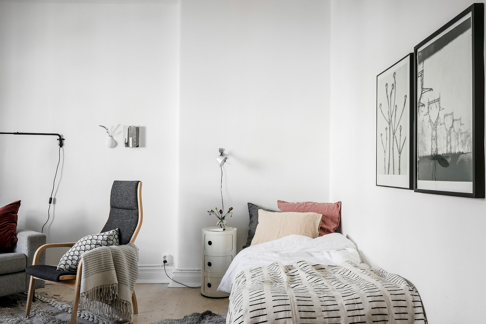 Gray IKEA sofy inside of a tiny Scandinavian apartment