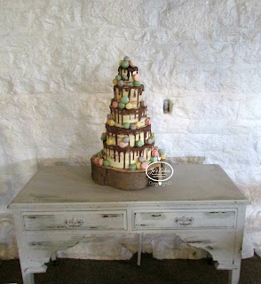 Drippy Five Tier Wedding Cake with Macarons at East Riddlesden Hall by White Rose Cake Design a bespoke cake maker in West Yorkshire