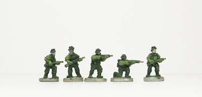 Advancing with rifle x 2 / Standing, firing / Kneeling, firing / Advancing with Bren MG: