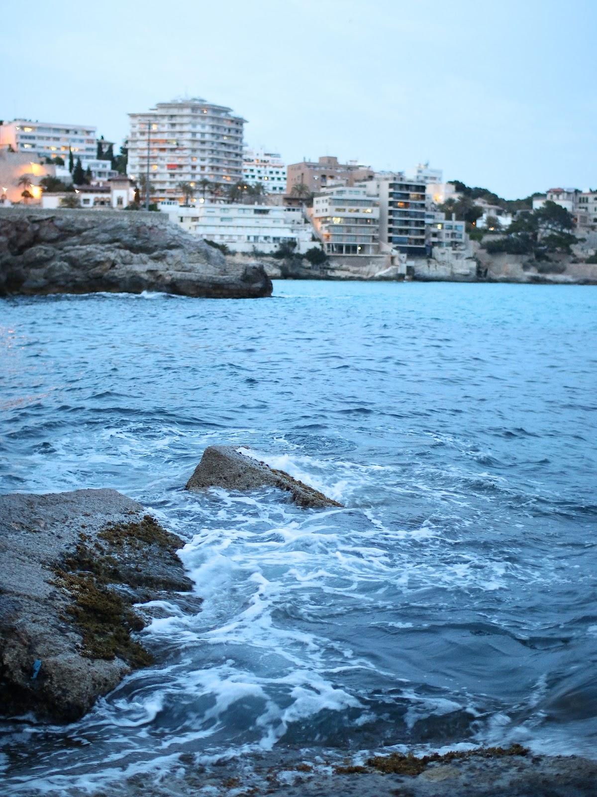 the ocean crashing into the rocks