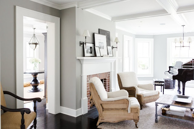 Modern farmhouse living room with chairs near fireplace on Hello Lovely Studio