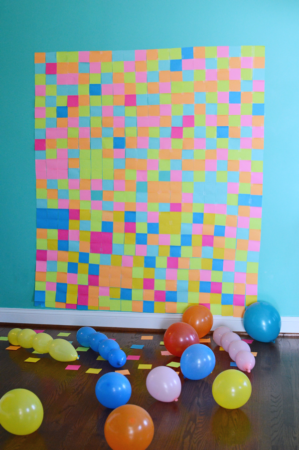 Over 500 multicolored post its were used to create this Roblox skin color changing inspired grid backdrop-designaddictmom