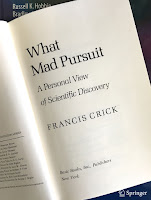 What Mad Pursuit: A Personal View of Scientific Discovery, by Francis Crick, superimposed on the cover of Intermediate Physics for Medicine and Biology.