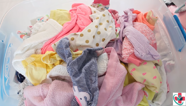 Always wash your little one's new clothes before dressing him or her