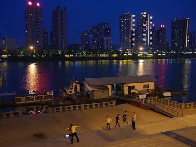 woman exercising at night next to the Xiang River in Hengyang