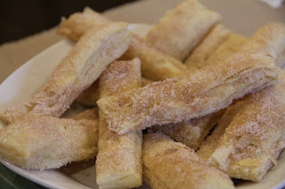 puff pastry dough churros on white plate