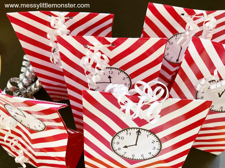 New years eve activities for kids. Countdown bags with printable clock faces.