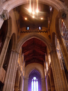 long view of arches and ceiling from Nave of Bryn Athyn Cathedral