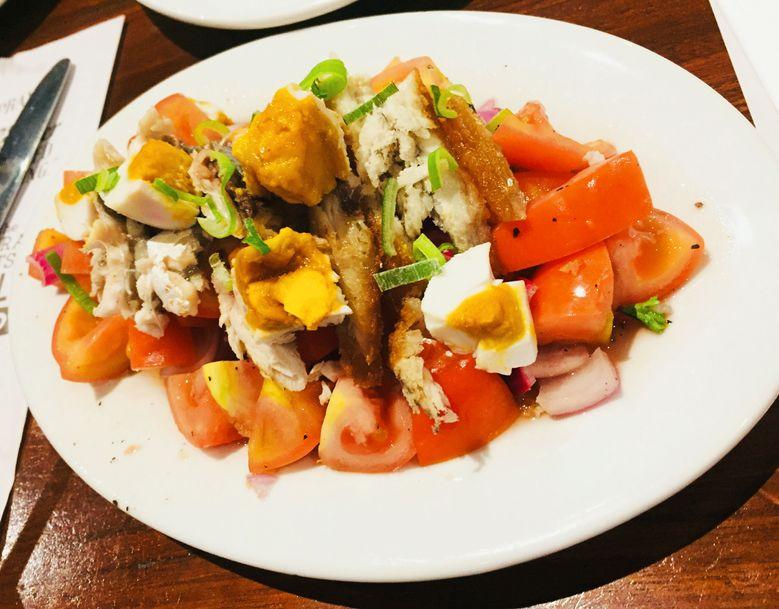 Red egg, tomatoes, and smoked bangus salad at Zubuchon