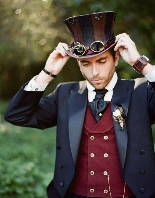 A Steampunk groom wearing a top hat, vest, jacket, and tie. Fashion inspiration for a Steampunk wedding.