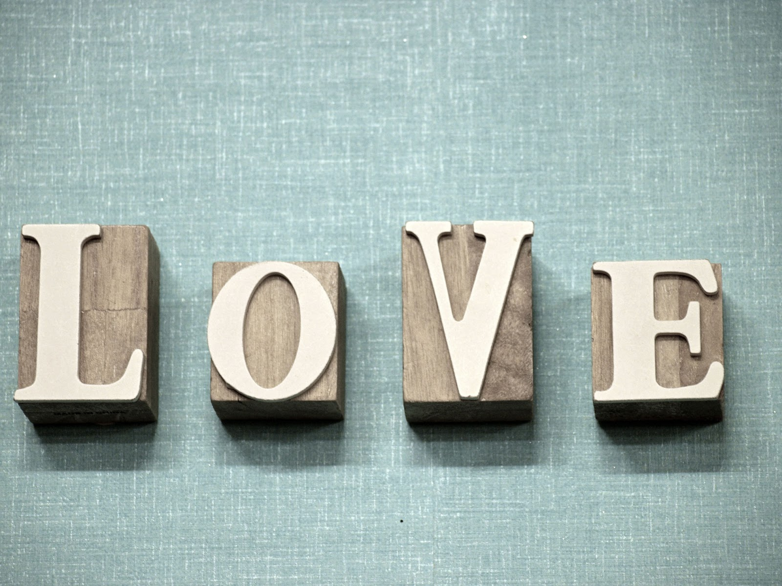 The word love spelled out in wooden blocks