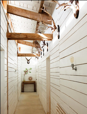 a rustic decor hallway in a home with shiplap on the walls