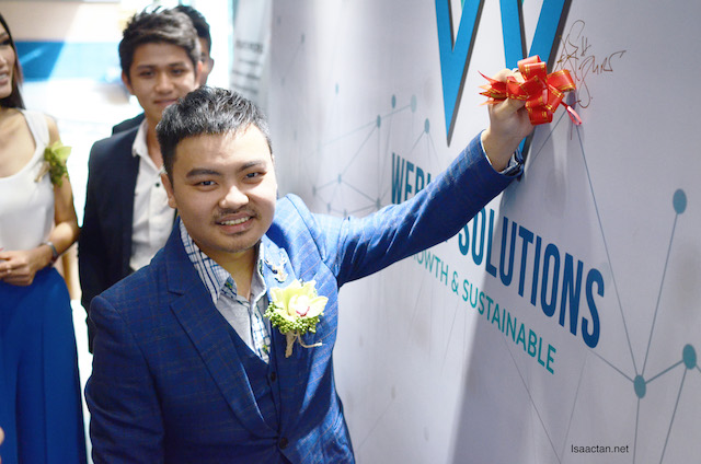 Dr Zyro Wong, advisor of WeBist Solutions signing at the launch