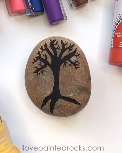 how to paint a tree with falling leaves on a rock