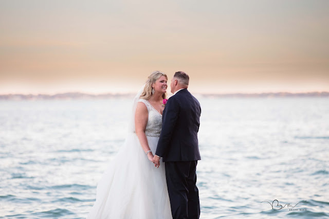 bride and groom on pier at new baltimore waterfront wedding