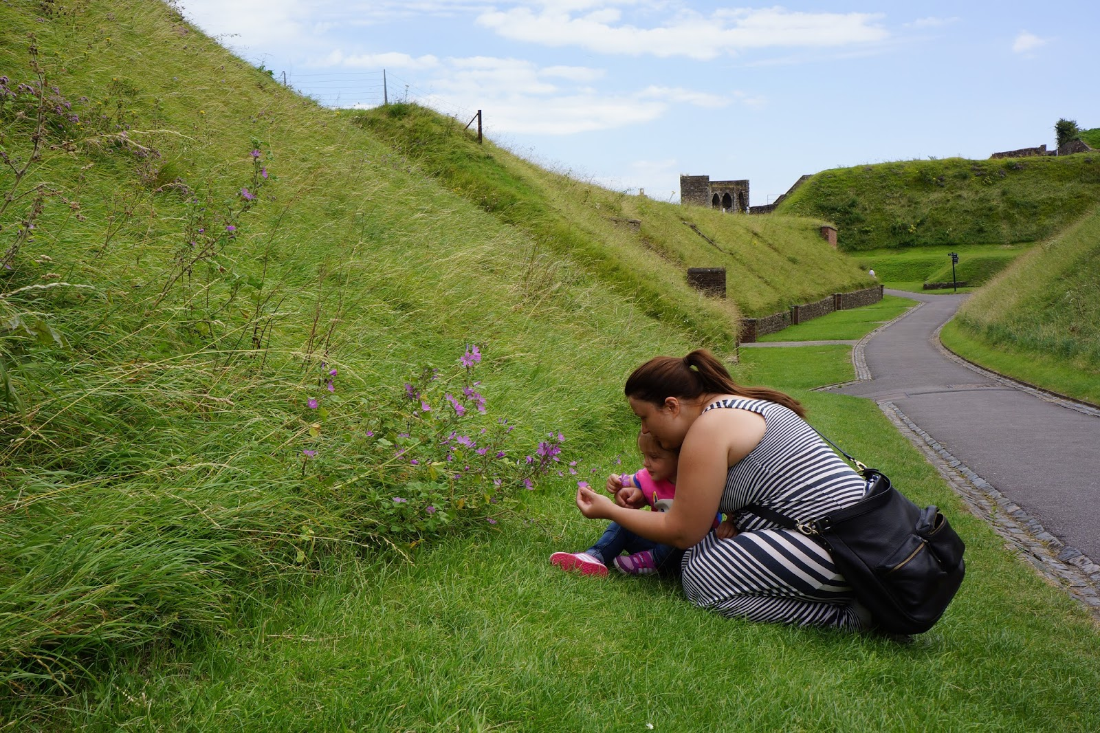 mum and daughter picking flowers at dover castle