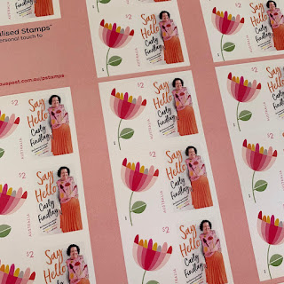 a sheet of postage stamps featuring the Say Hello cover.