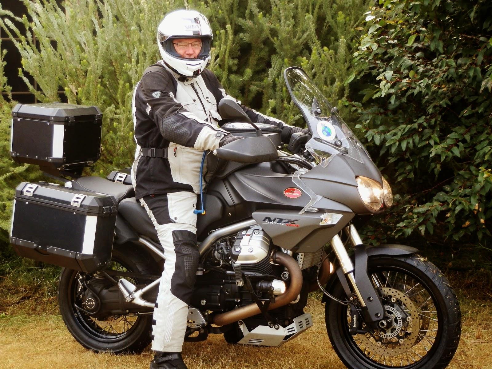 the wrong way round moto guzzi stelvio ntx vs bmw r1200gs adventure