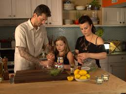 Corcos, Mazar and one of their daughters in action in their TV kitchen