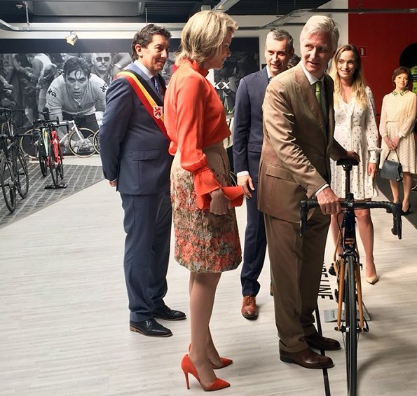 King Philippe of Belgium and Queen Mathilde of Belgium visited the Global Cycling Center ( Flanders' Bike Valley). Queen wore Natan and Armani blouse