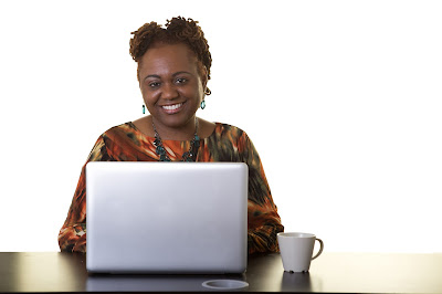 Smiling woman at computer