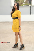 Actress Poojitha Stills in Yellow Short Dress at Darshakudu Movie Teaser Launch .COM 0319.JPG
