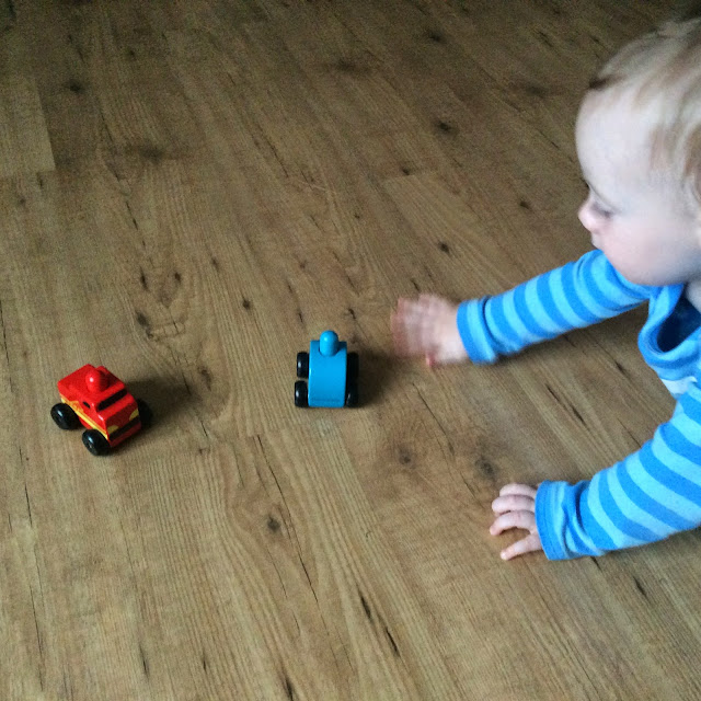 boy playing with Discoveroo Squeaker Emergency Cars Set