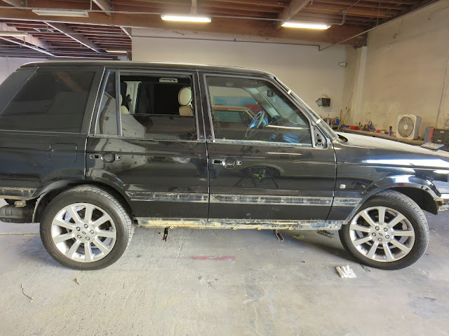 Range Rover with scratches & caked in mud from off road adventures.