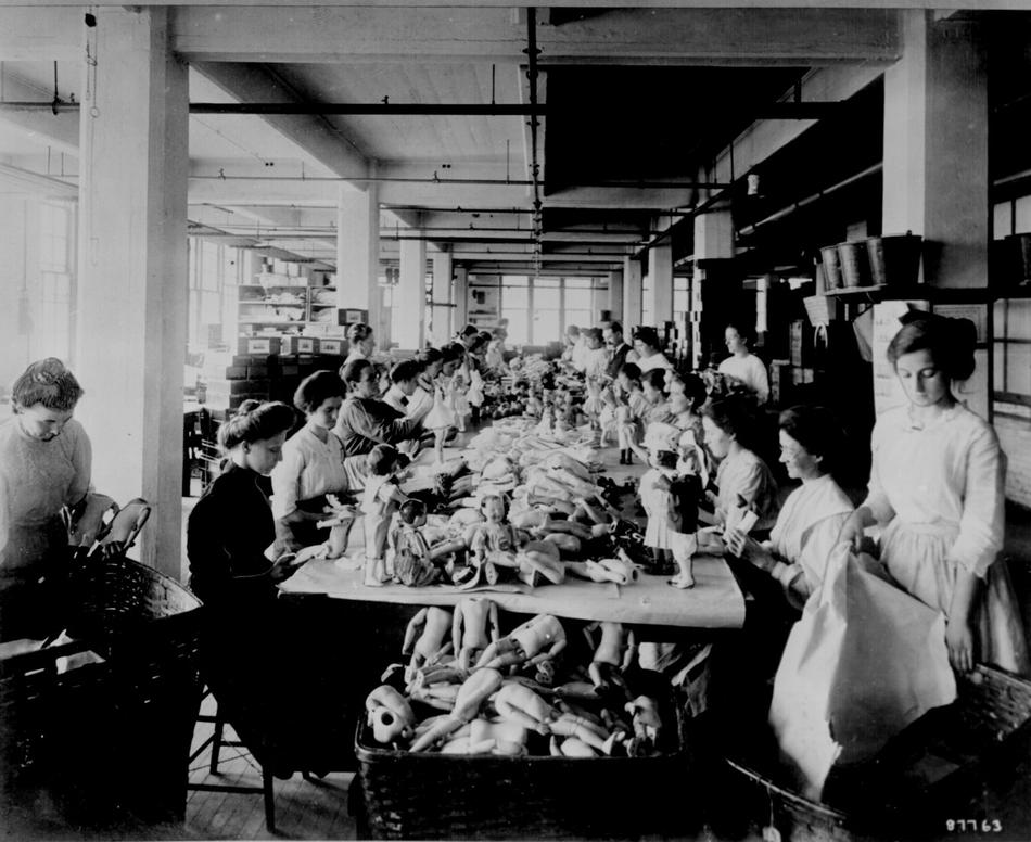 Women assembling dolls on a long worktable at the shrenhat toy company philadelphia oct 1912