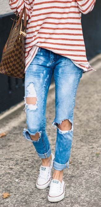 cute street style outfit: top + bag + ripped jeans