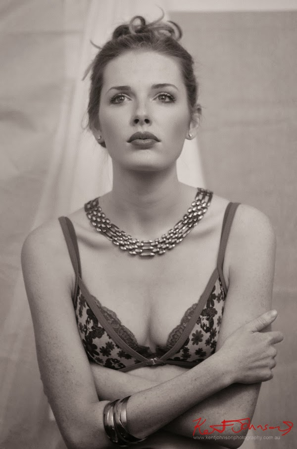 Lingerie, Hayley in bra and necklace, arms crossed, sepia picture - Modelling portfolio by Kent Johnson.