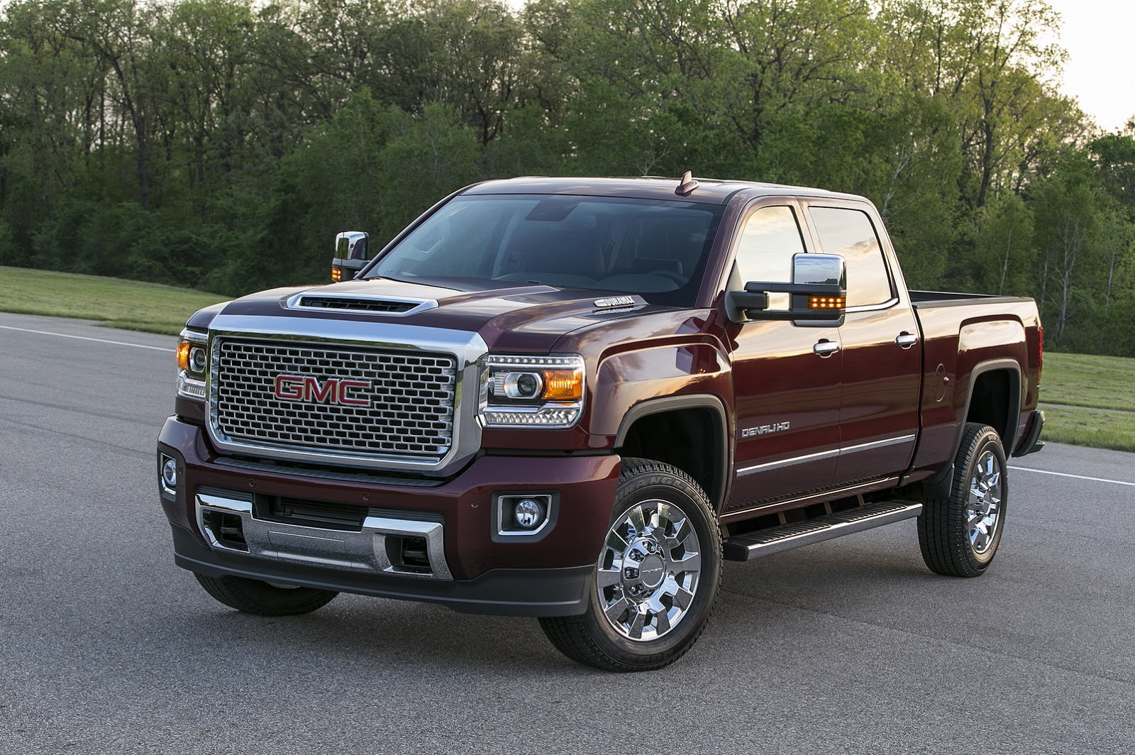 gmc for any thing Not only does it come with a new tailgate that is unlike anything we've ever seen  but  does the gmc sierra really have a carbon fiber bed.