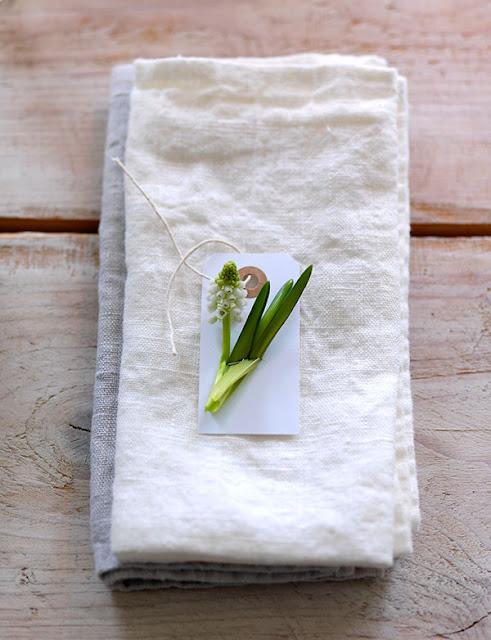 Gorgeous spring bloom on linen napkin on farmhouse table