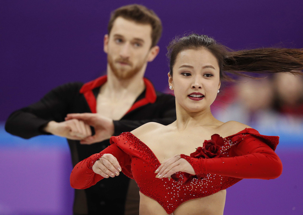 South Korean Min Yura battled on after a hook popped on her dress just seconds into her routine