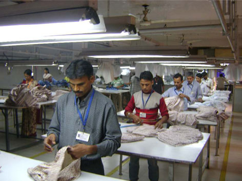 Quality inspector checking garments
