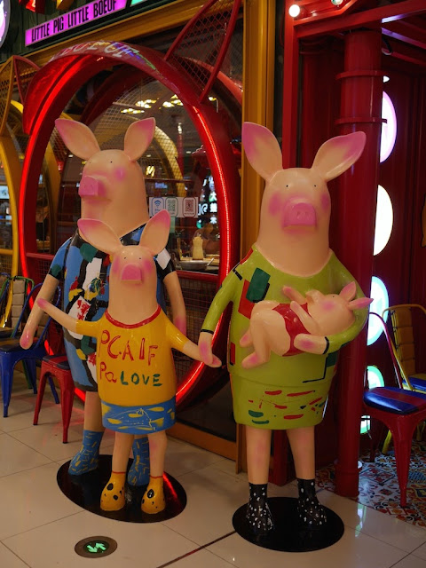 humanoid pig family statues at the Mudanjiang Wanda Plaza