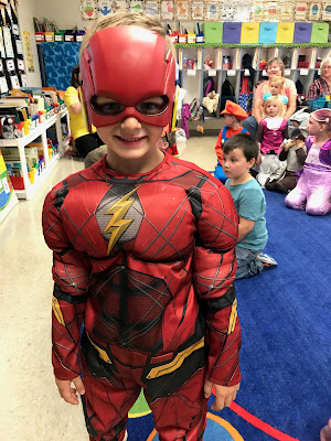 Young boy dressed as super hero