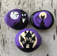 Decoración para Halloween con piedras pintadas violeta