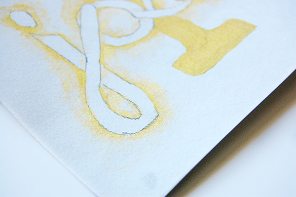 watercolor paper using gold leafing upclose image