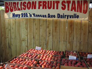 Flats of juicy peaches from the Burlison Fruit Stand, Dairyville, CA