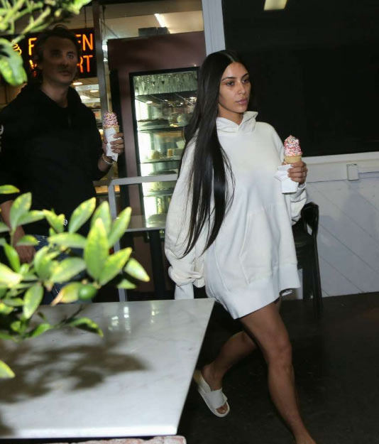 Kim K and her no makeup face step out looking very sad