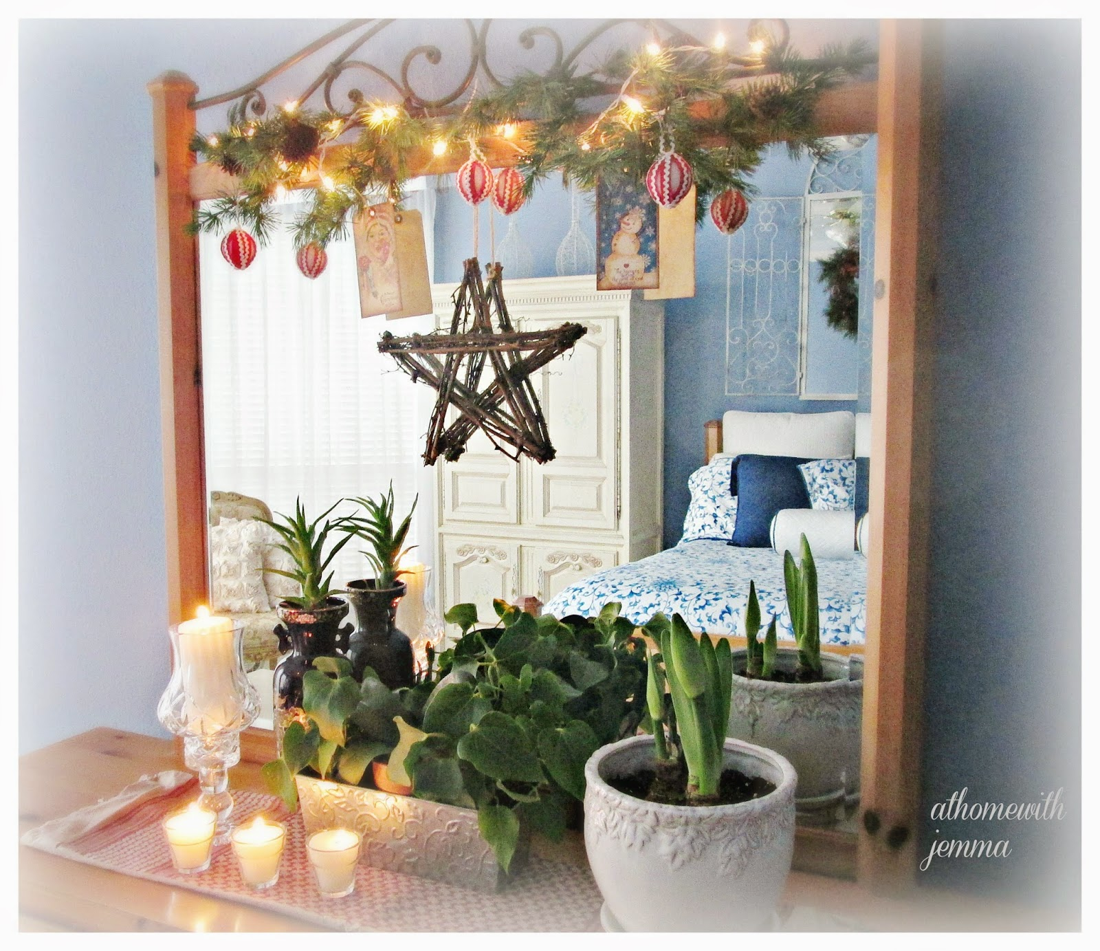 Candles, amaryllis, garland, red and white added to blue