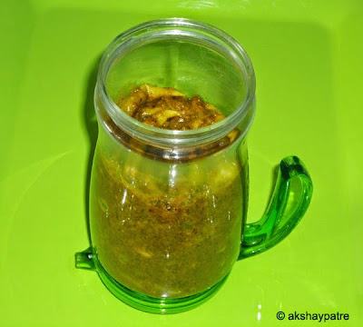 Green chilli pickle in a jar