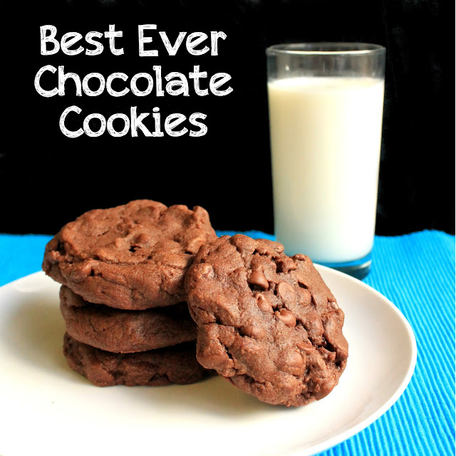 Freshly baked Best Ever Chocolate Cookies stacked on a plate, served with a cold glass of milk