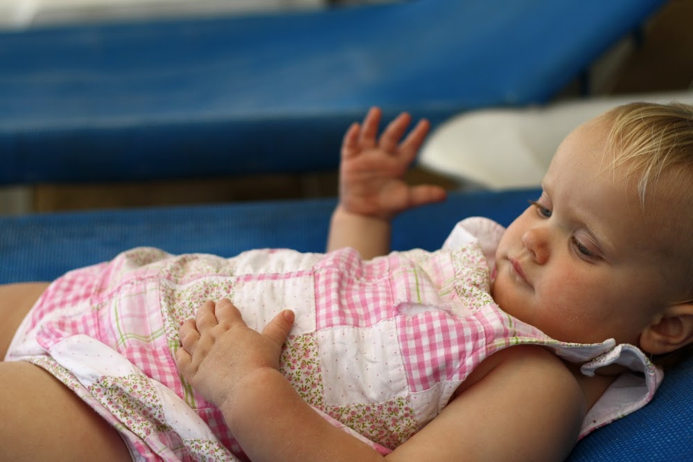 baby relaxing on beach