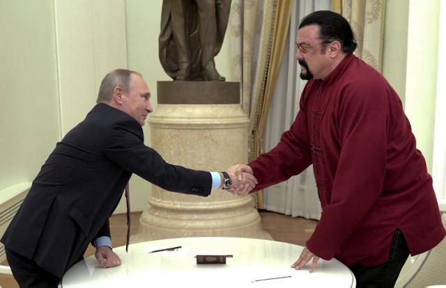 Vladimir Putin Presents 'Honored' Actor Steven Seagal With A Russian Passport