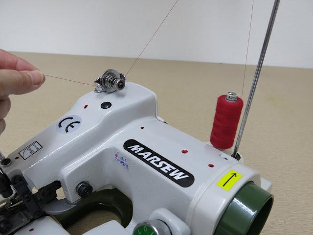como regular la tensión del hilo en la máquina de coser